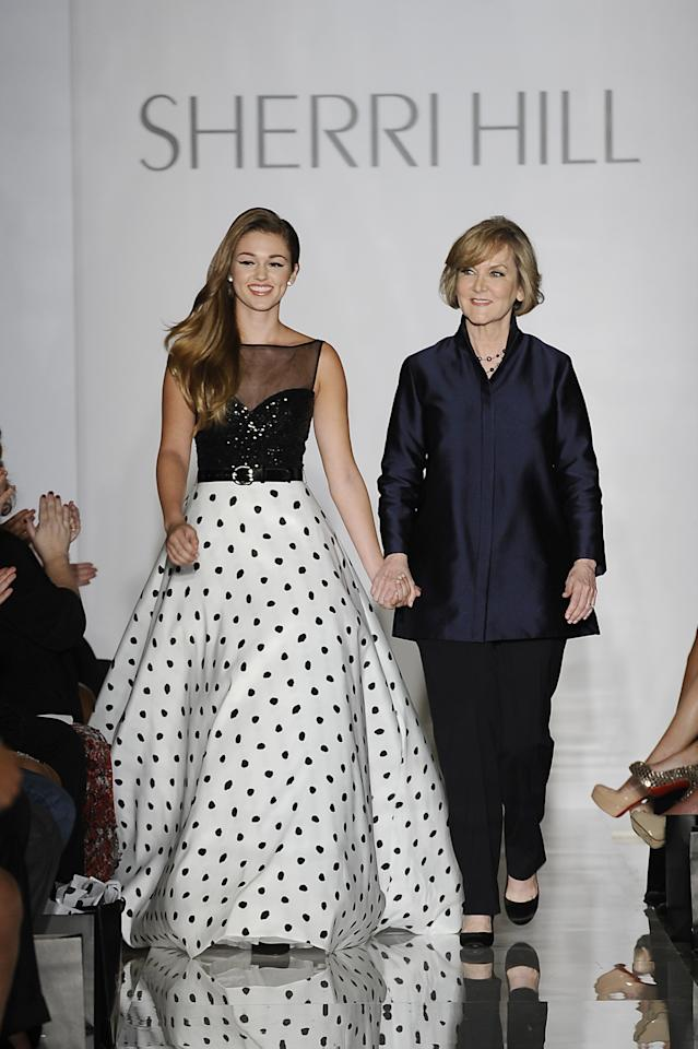 NEW YORK, NY - SEPTEMBER 09: Sadie Robertson and Sherri Hill walk the runway at an Evening By Sherri Hill fashion show during Mercedes-Benz Fashion Week Spring 2014 at Trump Tower on September 9, 2013 in New York City. (Photo by Fernanda Calfat/Getty Images)