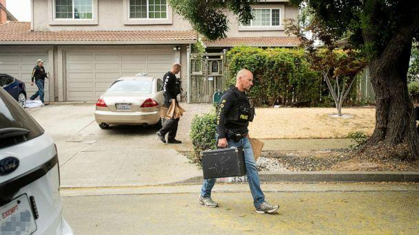 PHOTO: Police officers carry evidence bags from the family home of Gilroy Garlic Festival shooting suspect Santino William Legan, July, 29, 2019, in Gilroy, Calif. (Noah Berger/AP)
