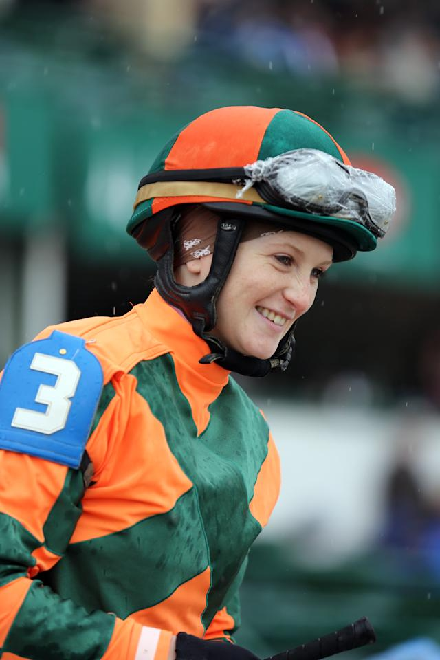 FILE - In this May 4, 2013 file photo, jockey Rosie Napravnik smiles on her mount before the Humana Distaff at Churchill Downs in Louisville, Ky. Napravnik is set to become the first female jockey to ride in all three Triple Crown races in the same year, and the first to try and win one aboard a filly. (AP Photo/Gregory Payan, File)