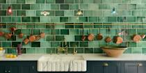 """<p>While <a href=""""https://www.veranda.com/decorating-ideas/color-ideas/g27147074/white-kitchen-ideas/"""" rel=""""nofollow noopener"""" target=""""_blank"""" data-ylk=""""slk:white-on-white kitchens"""" class=""""link rapid-noclick-resp"""">white-on-white kitchens</a> may be a versatile and timeless color choice, recently, they've been feeling a bit...well, vanilla. Enter the new shade that's quickly found its way into our hearts, not to mention the hearts of our home: verdant, dazzling green. </p><p>From earthy olives to vibrant limes and vivid emeralds, green is a refreshing, yet comforting and crowd-pleasing shade with botanical notes that brings the outside in. When seen on painted cabinetry or a glossy range, for instance, it provides a striking backdrop to au courant antiqued brass finishes and sleek appliances. The color also plays nicely with everything from white marbles to Moroccan zellige tile and beyond. </p><p>Whether you are looking to swathe an entire kitchen in a vivid chartreuse paint, create a <a href=""""https://www.veranda.com/home-decorators/a35685600/wallpaper-backsplash/"""" rel=""""nofollow noopener"""" target=""""_blank"""" data-ylk=""""slk:striking backsplash"""" class=""""link rapid-noclick-resp"""">striking backsplash</a> of pea-green tiles on a wall, or even bring a hint of mint to a stovetop by way pots and pans, we've rounded up 12 essential finds to help bring a little of our new <a href=""""https://www.veranda.com/decorating-ideas/color-ideas/g28700927/kitchen-paint-colors/"""" rel=""""nofollow noopener"""" target=""""_blank"""" data-ylk=""""slk:favorite hue"""" class=""""link rapid-noclick-resp"""">favorite hue</a> to any kitchen, no green thumb required! </p>"""