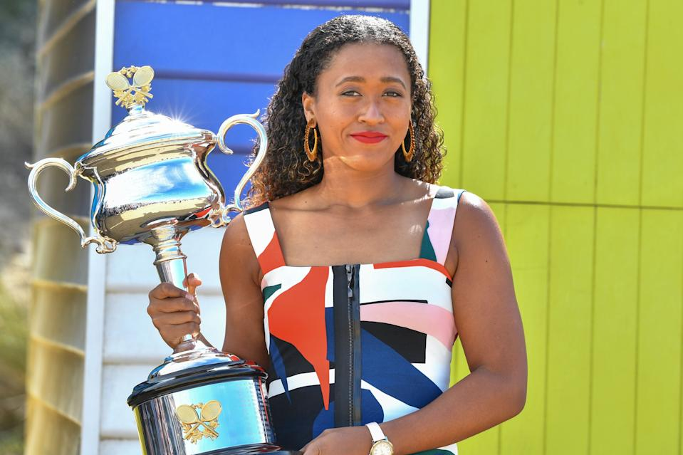TOPSHOT - Japan's Naomi Osaka poses for photographs with the championship trophy at the Brighton Beach in Melbourne on January 27, 2019, a day after her victory against Czech Republic's Petra Kvitova in the women's singles final at the Australian Open tennis tournament. (Photo by Saeed KHAN / AFP) / -- IMAGE RESTRICTED TO EDITORIAL USE - STRICTLY NO COMMERCIAL USE --        (Photo credit should read SAEED KHAN/AFP/Getty Images)