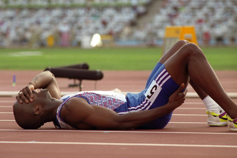DEREK REDMOND (GBR) LIES ON THE FLOOR IN AGONY AFTER AN INJURY IN THE 400M  (Photo by Ross Kinnaird/EMPICS via Getty Images)