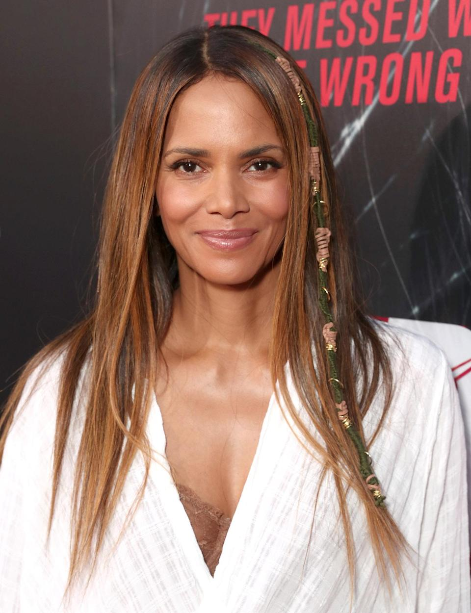"<p>The <em>Kidnap</em> star has been having some amazing hair days while promoting her new film. Here <a href=""https://www.yahoo.com/beauty/halle-berry-turning-everyones-favorite-hair-crush-174855626.html"" data-ylk=""slk:Berry rocks the popular hair wraps;outcm:mb_qualified_link;_E:mb_qualified_link;ct:story;"" class=""link rapid-noclick-resp yahoo-link"">Berry rocks the popular hair wraps</a> trend, adding a bit of texture to her pin-straight strands. (Photo: Getty Images) </p>"