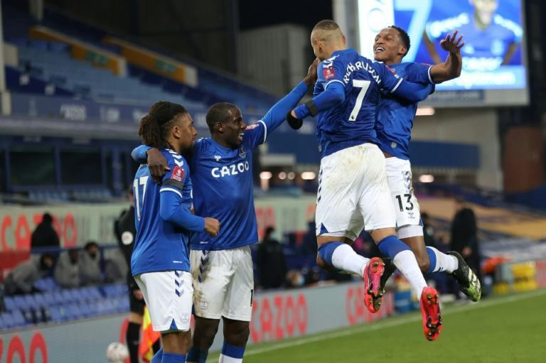 High fives: Everton edged out Tottenham 5-4 after extra-time in a thrilling FA Cup tie