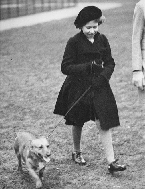Queen Elizabeth (then Princess Elizabeth) continued to walk her corgis through the years. Here she wears a matching hat and jacket, with the cutest pup as an accessory.