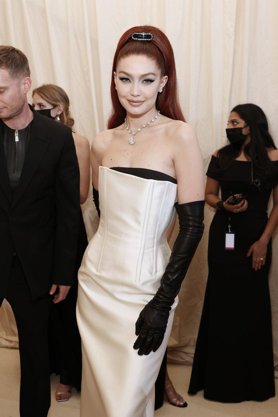 <p>Gigi Hadid is a redhead now! The model pulled her copper-red hair into a high ponytail, emphasizing her cat-eye winged liner and muted lips. </p>