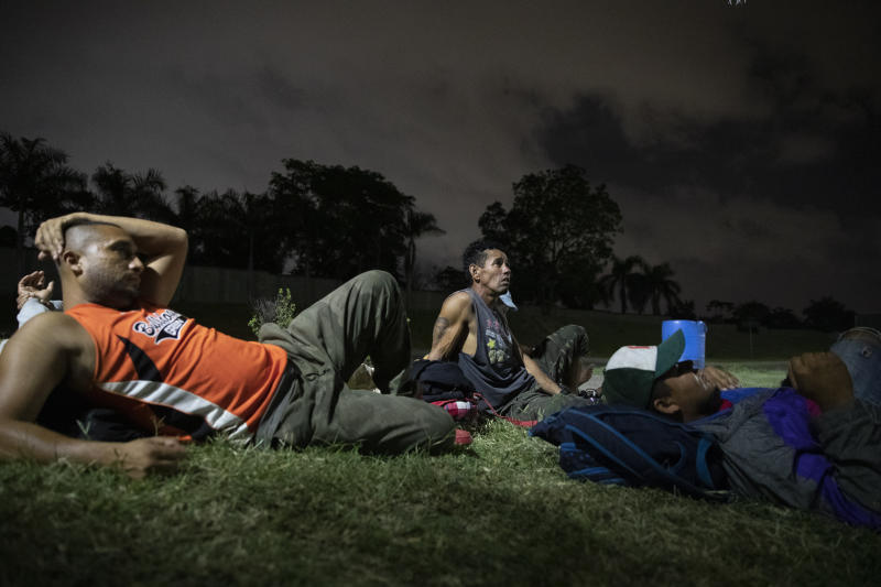 "Hondurans deported from Mexico rest near a bus terminal in San Pedro Sula, Honduras, on Nov. 28, 2019, waiting for transportation to continue the trip back to their communities. The Trump Administration insists that Central Americans in danger already have safe havens. ""For those of you who have legitimate asylum claims, we encourage them to go and seek assistance from the first neighboring country,"" Acting Customs and Border Protection Commissioner Mark Morgan recently told reporters. (AP Photo/Moises Castillo)"