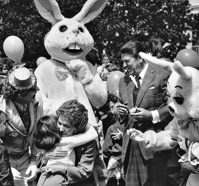 <p>First lady Nancy Reagan hugs a participant as President Ronald Reagan signs eggs during the annual Easter Egg Roll on the South Lawn of the White House, April 4, 1983. (Photo: John McDonnell/The Washington Post via Getty Images) </p>