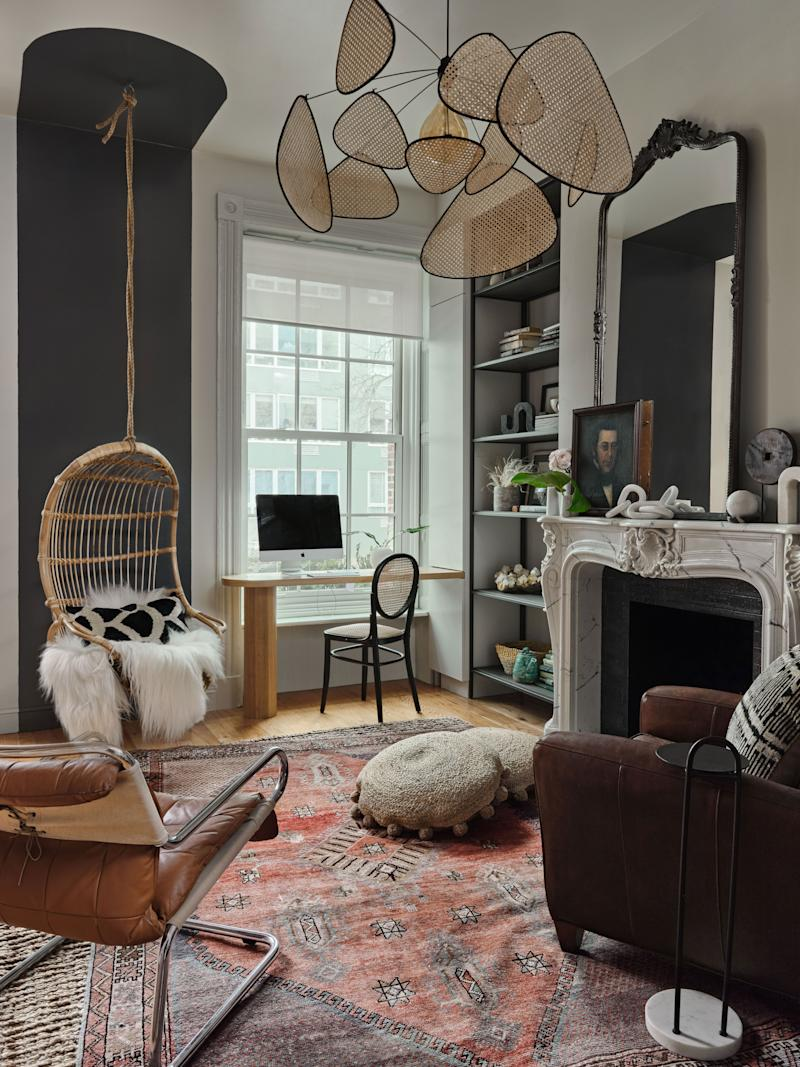 The playful parlor includes the prized swing chair, a custom desk with hidden storage, and a period-appropriate mantel.