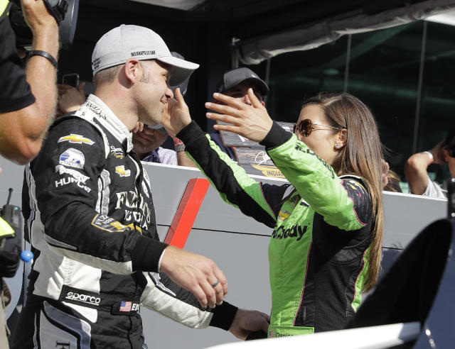 Ed Carpenter is hugged by Danica Patrick after Carpenter won the pole for the IndyCar Indianapolis 500 auto race at Indianapolis Motor Speedway, in Indianapolis Sunday, May 20, 2018. (AP Photo/Darron Cummings)
