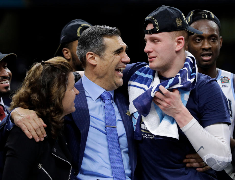 The celebration of Villanova's national championship last April was short lived for Jay Wright (middle) and Donte DiVencenzo after some controversial old tweets resurfaced shortly after the title game ended. (AP)