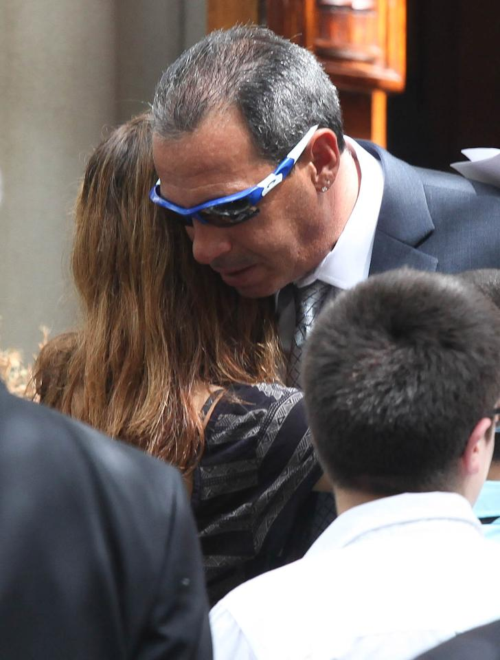 """NEW YORK, NY - AUGUST 22: The father of former """"Bachelor"""" contestant Gia Allemand attends the funeral for Gia Allemand at Trinity Grace Church on August 22, 2013 in New York, New York. Allemand passed away on Wednesday, August 14th of an apparent suicide. (Photo by Rob Kim/Getty Images)"""