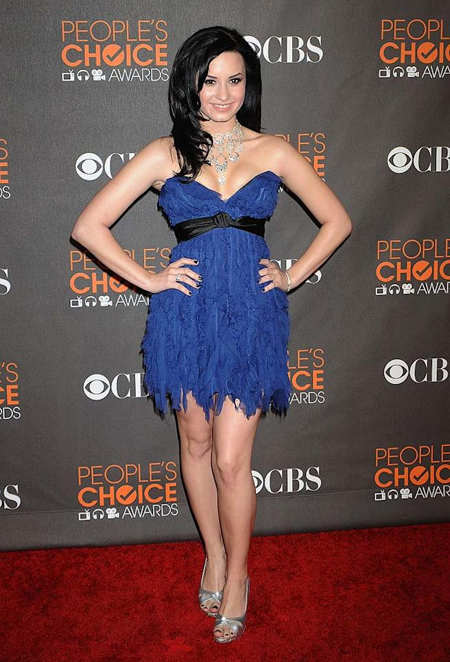 "Demi Lovato over accessorized her Jenny Packham ruffled mini with a choker that somehow managed to make her look much older than her 17 years of age. Jeffrey Mayer/<a href=""http://www.wireimage.com"" target=""new"">WireImage.com</a> - January 6, 2010"