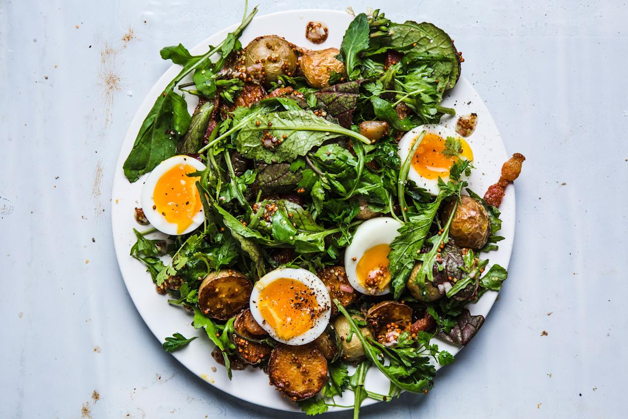 """Who said potato salad had to be boring? Or egg salad, for that matter! This deconstructed salad combines the best of both worlds, and is versatile to be served for breakfast, lunch, or dinner. <a href=""""https://www.bonappetit.com/recipe/summer-greens-mustardy-potatoes-six-minute-egg?mbid=synd_yahoo_rss"""">See recipe.</a>"""