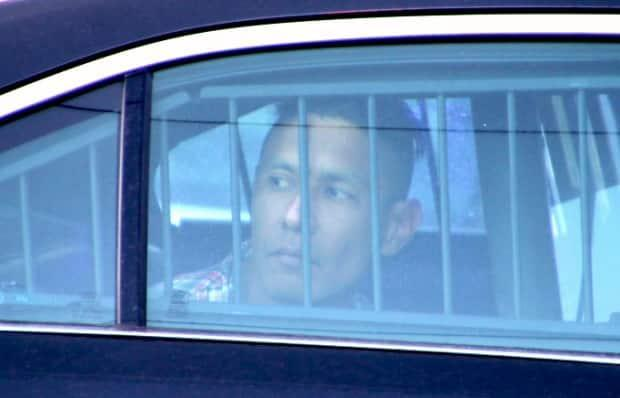 Keeton Michel Gagnon is seen in the back of a police cruiser shortly after being arrested. Gagnon is charged with second-degree murder in the stabbing death of Nicolas Nwonye.  (David Bell/CBC - image credit)