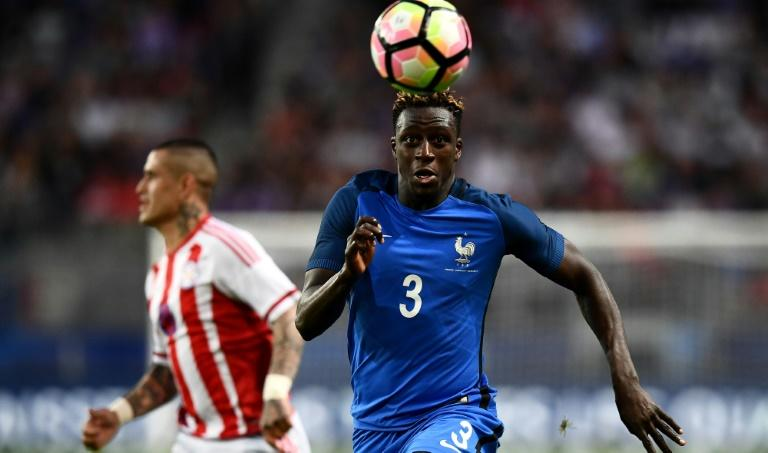France's defender Benjamin Mendy (right) eyes the ball during a friendly match against Paraguay on June 2, 2017 at the Roazhon Park stadium in Rennes