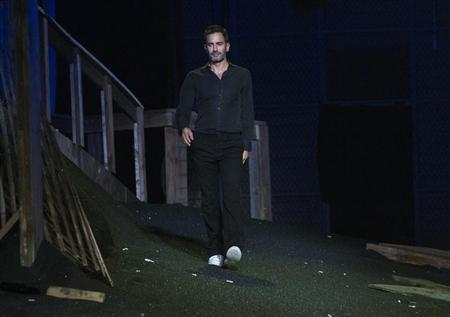 Designer Marc Jacobs greets the audience during his Spring/Summer 2014 collection show during New York Fashion Week