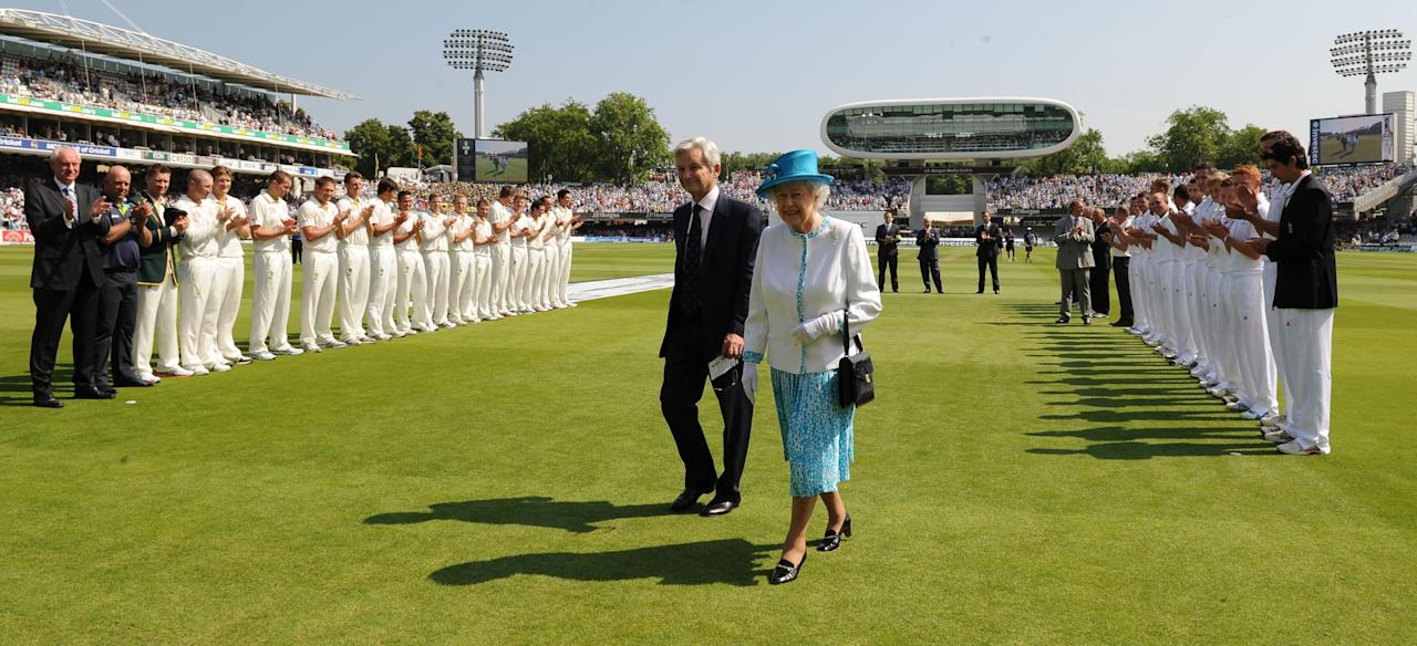 Queen Elizabeth II leaves the field after meeting the England and Australian players at Lord's Cricket Ground, London, ahead of the first day of the second test between England and Australia.