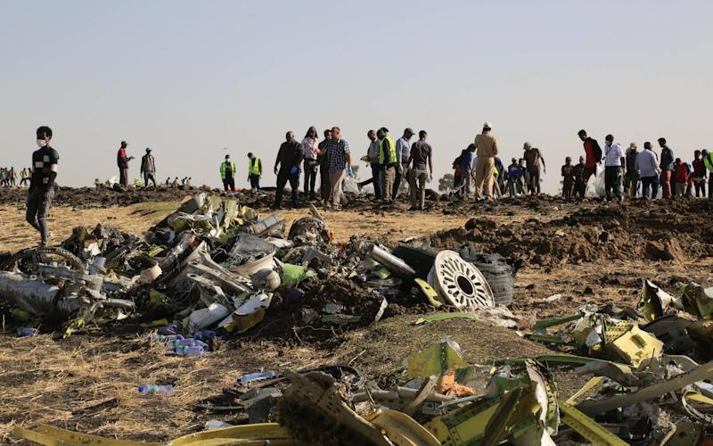 Rescuers work at the crash site of Ethiopian Airlines flight ET302 during the continuing recovery efforts - Visual China Group