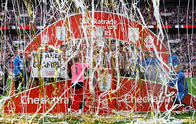 "Soccer Football - Checkatrade Trophy Final - Lincoln City vs Shrewsbury Town - Wembley Stadium, London, Britain - April 8, 2018 Lincoln City lift the trophy Action Images/Matthew Childs EDITORIAL USE ONLY. No use with unauthorized audio, video, data, fixture lists, club/league logos or ""live"" services. Online in-match use limited to 75 images, no video emulation. No use in betting, games or single club/league/player publications. Please contact your account representative for further details."