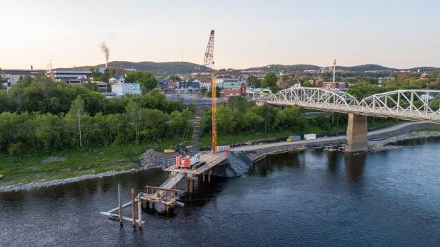 Work has started on both sides of the border to build a temporary trestle that will be used to build the new bridge.  (Submitted/Steven Deschaine - image credit)