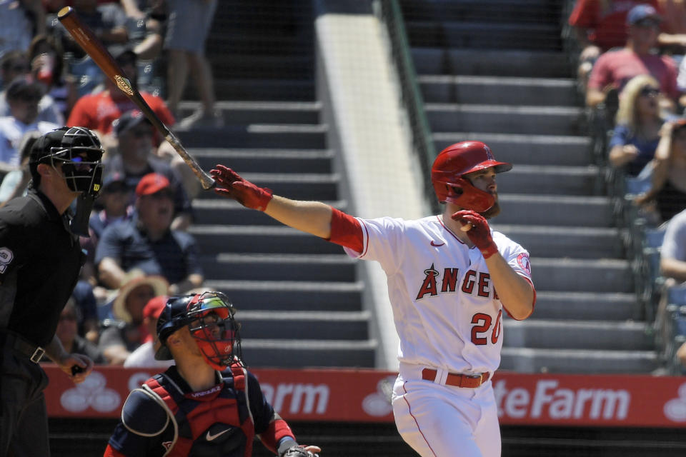 Los Angeles Angels' Jared Walsh, right, hits a solo home run as Boston Red Sox catcher Christian Vazquez, center, and home plate umpire Adam Beck watch during the fifth inning of a baseball game Wednesday, July 7, 2021, in Anaheim, Calif. (AP Photo/Mark J. Terrill)