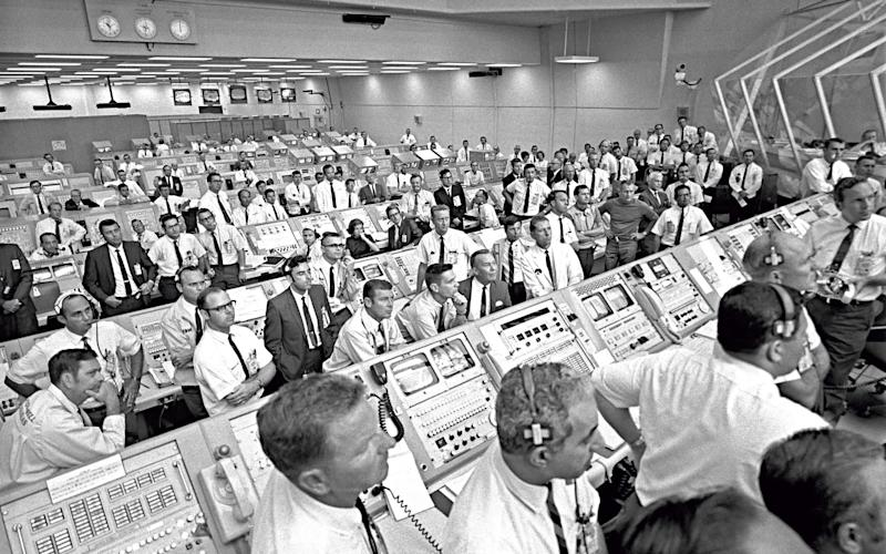 Firing Room 1 at Nasa's Launch Control Center, with JoAnn Morgan at her desk during the Apollo 11 launch, 16 July 1969 -