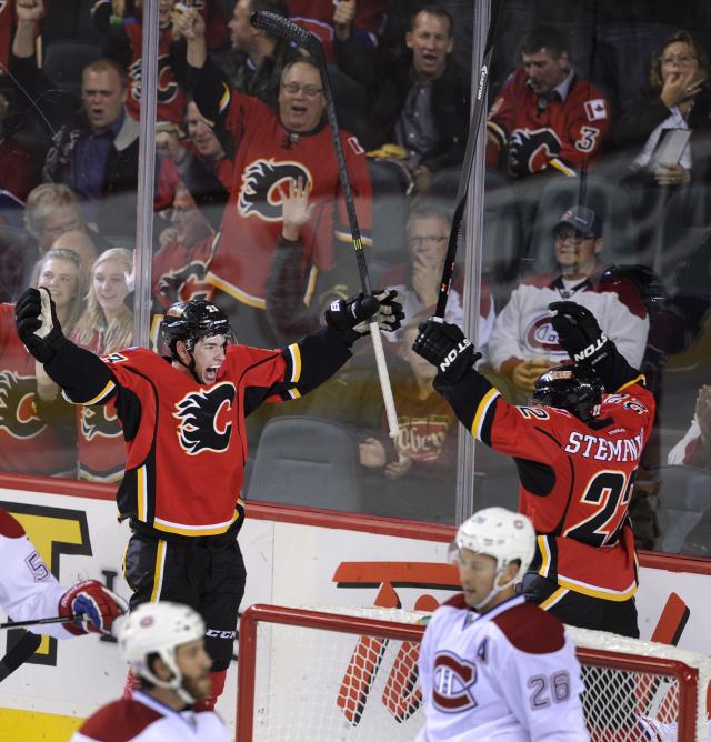 Calgary Flames' Sean Monahan, left, celebrates his goal against the Montreal Canadiens with Lee Stempniak during the first period of an NHL hockey game Wednesday, Oct. 9, 2013, in Calgary, Alberta. (AP Photo/The Canadian Press, Larry MacDougal)