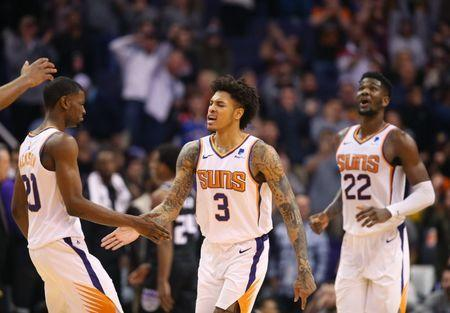 Jan 8, 2019; Phoenix, AZ, USA; Phoenix Suns forward Kelly Oubre Jr. (3) celebrates with guard Jamal Crawford (20) and center Deandre Ayton in the second half against the Sacramento Kings at Talking Stick Resort Arena. Mandatory Credit: Mark J. Rebilas-USA TODAY Sports