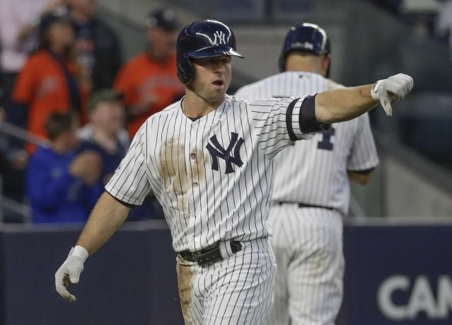 New York Yankees' Brett Gardner reacts after scoring during the third inning of Game 5 of baseball's American League Championship Series against the Houston Astros Wednesday, Oct. 18, 2017, in New York. (AP)