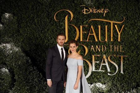 Actors Dan Stevens and Emma Watson pose for photographers at a media event for the film Beauty and the Beast in London