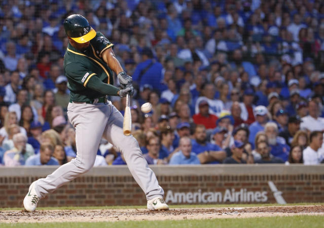 Oakland Athletics' Marcus Semien hits two-run home run against the Chicago Cubs during the third inning of a baseball game, Monday, Aug. 5, 2019, in Chicago. (AP Photo/Kamil Krzaczynski)