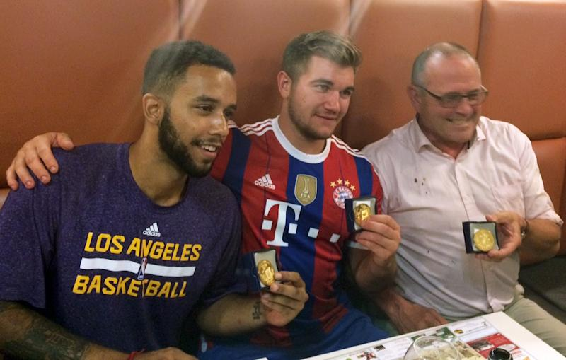 Passengers (from left) Anthony Sadler and Alek Skarlatos from the United States, and Briton Chris Norman were awarded medals for bravery after they overpowered a gunman who opened fire on a train from Amsterdam to Paris on August 21, 2015 (AFP Photo/-)