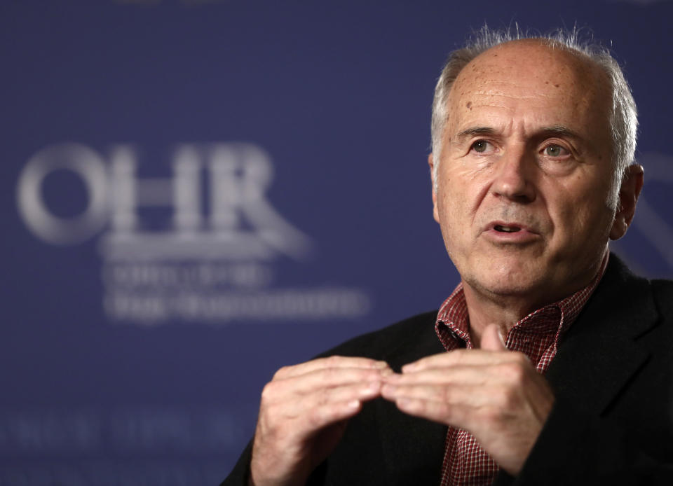 """Valentin Inzko, the outgoing head of Bosnia's Office of the High Representative, or OHR, speaks during an interview with the Associated Press, in the capital Sarajevo, Bosnia, Monday, July 26, 2021. Bosnia's outgoing top international overseer has urged the Western powers to urgently adopt a new approach to the politically fragmented post-war country to stop its """"not sincere"""" nativist leaders from turning it into a deserted wasteland. (AP Photo)"""