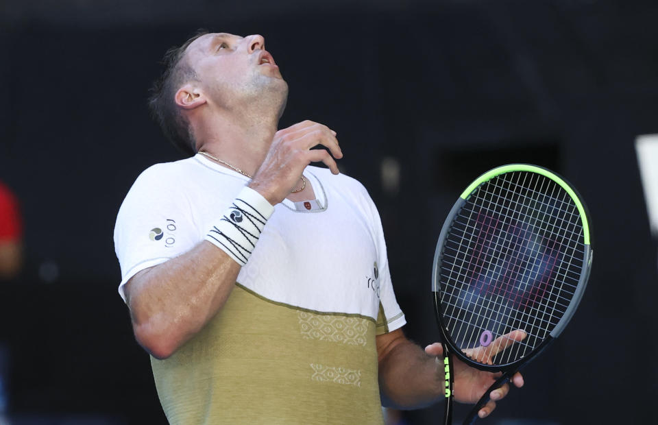 United States' Tennys Sandgren reacts during his match against Australia's Alex De Minaur during their first round match at the Australian Open tennis championship in Melbourne, Australia, Tuesday, Feb. 9, 2021.(AP Photo/Hamish Blair)