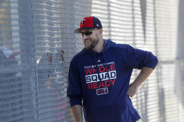 FILE - In this Thursday, Feb. 14, 2019, file photo, Minnesota Twins manager Rocco Baldelli talks through a fence as pitchers and catchers report for their first workout at their spring training baseball facility in Ft. Myers, Fla. The Twins are starting fresh with the youngest manager in the major leagues, a remade infield and a new closer. Starting fresh doesn't have to mean starting over, though, and the Twins have designs on contending for the division title. (AP Photo/Gerald Herbert, File)