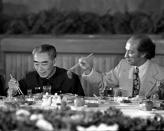 Former Chinese premier Zhou Enlai gets served some food by former prime minister Pierre Trudeau during a banquet held at the Great Hall of the People in Beijing, China, on Oct. 12, 1973. THE CANADIAN PRESS/PETER BREGG