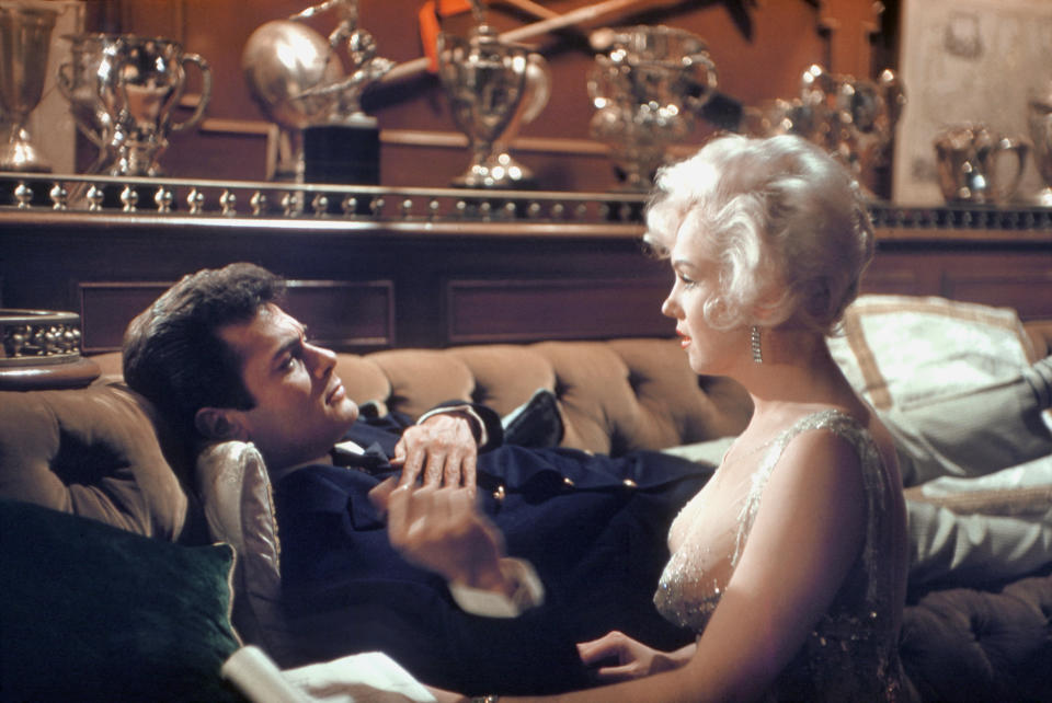 """Actress Marilyn Monroe and Tony Curtis during a scene from the movie """"Some Like it Hot"""" in Los Angeles, California. (Photo by Richard Miller/Getty Images)"""