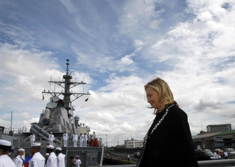 FILE - In this Nov. 16, 2011, file photo U.S. Secretary of State Hillary Rodham Clinton boards the USS Fitzgerald guided-missile destroyer for the 60th anniversary ceremony marking the Mutual Defense Treaty between the U.S. and the Philippines at Manila's South Harbor. Washington is turning its attention more to the Asia-Pacific region, has increased military aid, and resolved to help its ally on maritime security. The steps come as the Philippines is locked in a standoff with China over competing territorial claims in the South China Sea. (AP Photo/Bullit Marquez, File)