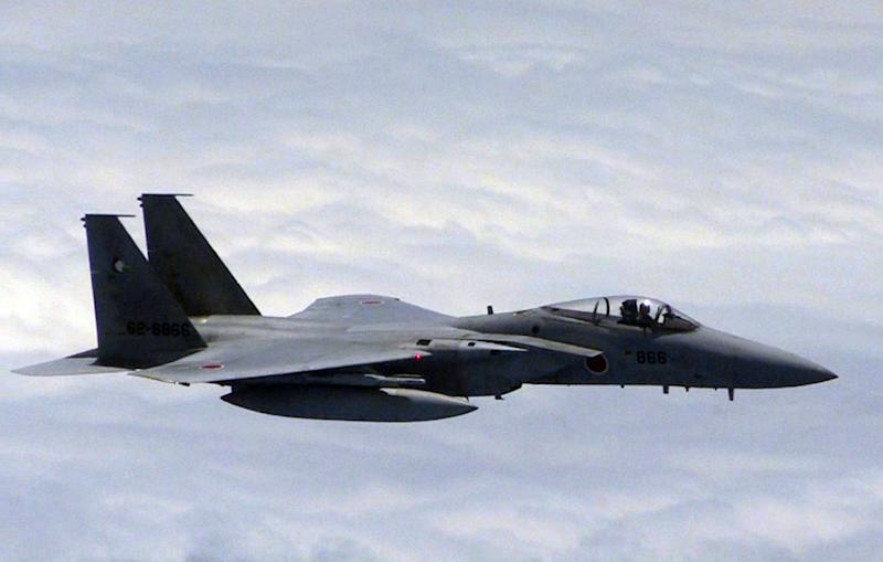 Japan dispatched four planes, including two F-15 fighters and an airborne warning and control system (AWACS) plane to waters surrounding the islets, Japan's defence ministry said