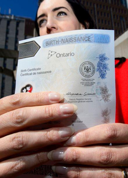 PHOTO: In this May 7, 2018, file photo, Joshua M. Ferguson who received Ontario's first non-binary birth certificate talks to the press at the Human Rights Monument in Ottawa, Ontario. (Sean Kilpatrick/The Canadian Press via AP, FILE)