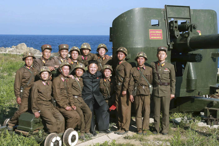 <p>North Korean leader Kim Jong Un poses with soldiers during an inspection of the defense detachment on Ung Islet, which is defending an outpost in the East Sea of Korea, in this undated photo. (KCNA/Reuters) </p>