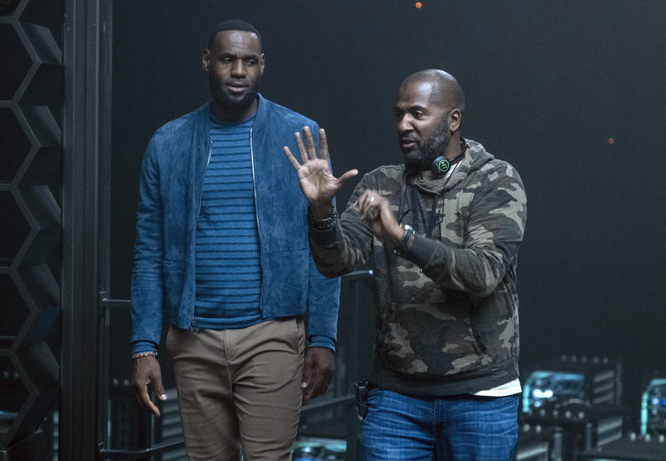 """This image released by Warner Bros. Entertainment shows LeBron James, left, with director Malcolm D. Lee on the set of """"Space Jam: A New Legacy,"""" in theater and on HBO Max on July 16. (Justin Lubin/Warner Bros. Entertainment via AP)"""
