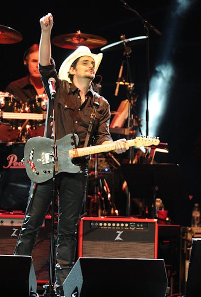 Brad Paisley performs at the George Jones Tribute - Playin' Possum: The Final No Show, on Friday, Nov. 22, 2013 at the Bridgestone Arena in Nashville, Tenn. (Photo by Frank Micelotta/Invision/AP)
