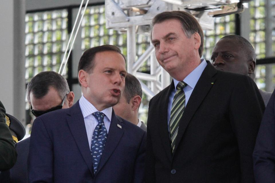The President of Brazil, Jair Bolsonaro and the Governor of Sao Paulo, Joao Doria, attend the Graduation Solemnity of the Higher Course of Technologist of Ostensive Police and Preservation of the Public Order (Sergeants Training Course), held in the city of Sao Paulo, this Friday. October 11, 2019.  (Photo by Fabio Vieira/FotoRua/NurPhoto via Getty Images)