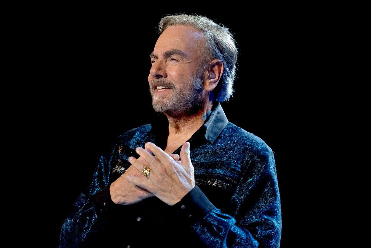 "The singer <a href=""https://people.com/music/neil-diamond-diagnosed-with-parkinsons-disease/"">announced his diagnosis</a> in January 2018, canceling the remainder of an upcoming world tour based on doctor's orders. But that wasn't going to stop him from continuing with his passion.  ""I plan to remain active in writing, recording and other projects for a long time to come,"" Diamond said in the statement. ""My thanks goes out to my loyal and devoted audiences around the world. You will always have my appreciation for your support and encouragement. This ride has been 'so good, so good, so good' thanks to you.""  Moved by their icon, fans in Australia and New Zealand who were issued tour ticket refunds <a href=""https://people.com/music/neil-diamond-thanks-fans-donating-ticket-refunds-parkinsons/"">were donating en masse to Parkinson's research organizations.</a>"