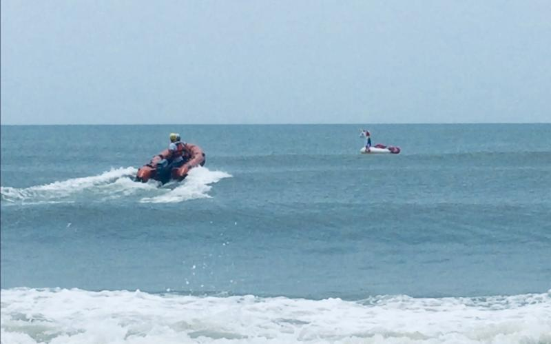 Rescuers at Oak Island, North Carolina, pictured, approaching the boy's inflatable unicorn. Source: Facebook/Oak Island Water Rescue