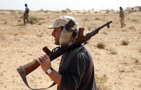 Libya Dawn fighters search for Islamic State militants during a patrol near Sirte
