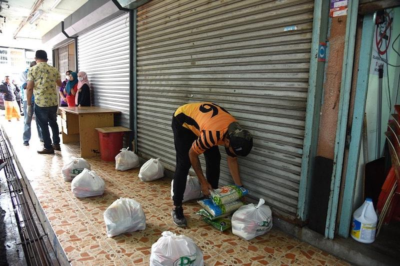 Essential groceries are ready to be distributed for those in need. — Picture courtesy of Facebook/ Kuan Chee Heng