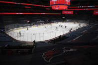 The Washington Capitals and the Buffalo Sabres compete amongst empty stands during the first period of an NHL hockey game, Friday, Jan. 22, 2021, in Washington. (AP Photo/Nick Wass)